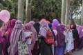 لماذا ترث المرأة نصف ما يرثه الرجل في الشريعة الإسلامية؟
